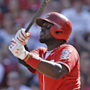 Cincinnati Reds' Brandon Phillips hits a double off Toronto Blue Jays starting pitcher J.A. Happ to drive in a run in the fourth inning of a baseball game, Saturday, June 21, 2014, in Cincinnati The Associated Press