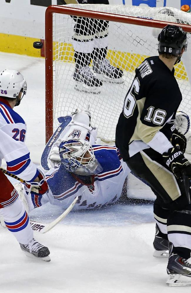 A goal by Pittsburgh Penguins' Jussi Jokinen bounces out of the goal above New York Rangers goalie Henrik Lundqvist (30) in the third period of game 2 of a second-round NHL playoff hockey series against the New York Rangers in Pittsburgh Sunday, May 4, 2014. The Penguins won 3-0, to tie the series at 1-1