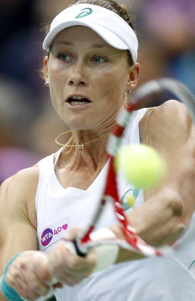 Australia's Samantha Stosur returns a shot to Romania's Simona Halep during their final match at the Kremlin Cup tennis tournament in Moscow, Russia, Sunday, Oct. 20, 2013