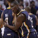 Indiana Pacers guard Darren Collison (2) hugs guard George Hill (3) after the Pacers defeated the Miami Heat 78-75 during Game 2 in an NBA basketball Eastern Conference semifinal playoff series, Tuesday, May 15, 2012, in Miami. (AP Photo/Wilfredo Lee)