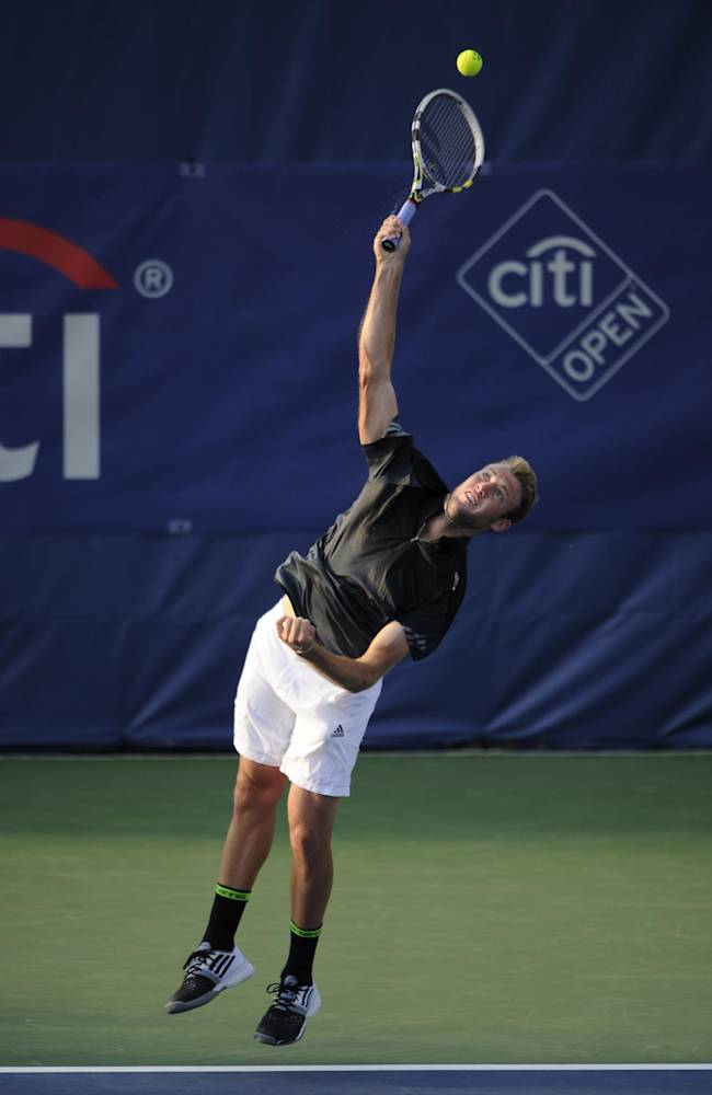 Jack Sock serves the ball against Michael Berrer, of Germany, during a match at the Citi Open tennis tournament, Tuesday, July 29, 2014, in Washington