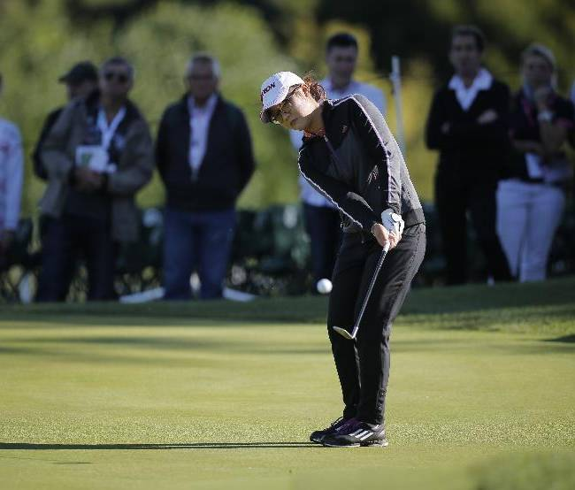 Lydia Ko of New Zealand plays on the 16th hole during the first round of the Evian Championship women's golf tournament in Evian, eastern France, Friday, Sept. 13, 2013