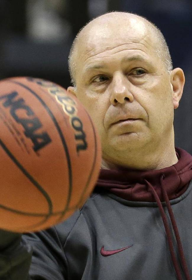 Arizona State head coach Herb Sendek passes the ball during a practice session for their NCAA college basketball tournament game Wednesday, March 19, 2014, in Milwaukee. Arizona State plays Texas State on Thursday