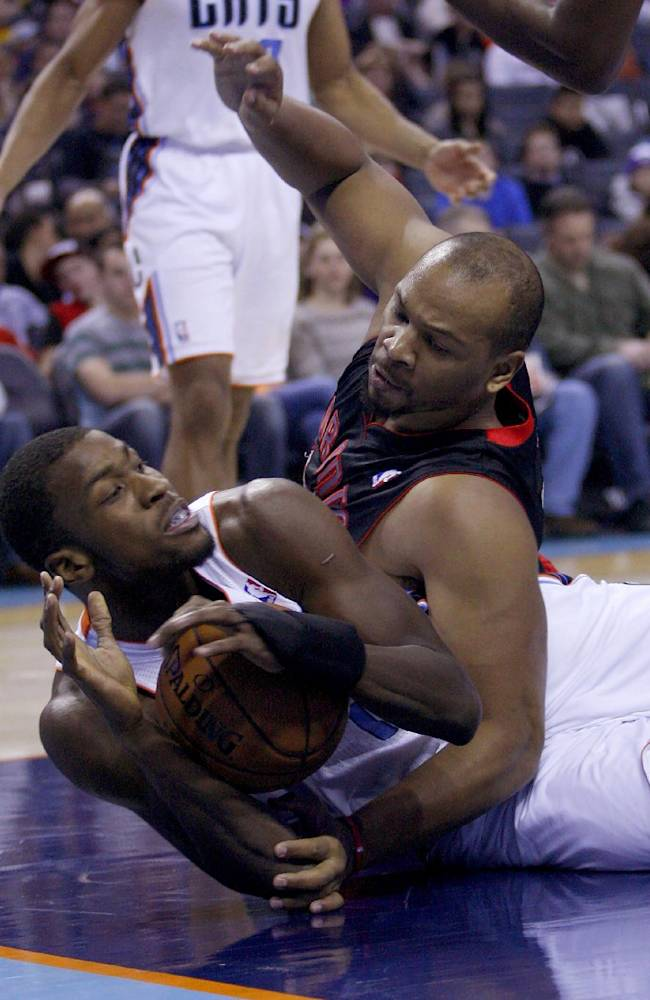 CORRECTS DATE - Charlotte Bobcats  forward Michael Kidd-Gilchrist, left, and Toronto Raptors forward Chuck Hayes battle for a loose ball in the first half of an NBA basketball game Monday, Jan. 20, 2014 in Charlotte, N.C