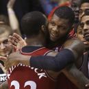 Cincinnati forward Titus Rubles hugs guard Sean Kilpatrick (23) late in the second half of an NCAA college basketball game against Memphis, Thursday, March 6, 2014, in Cincinnati. Cincinnati won 97-84. (AP Photo/Al Behrman)