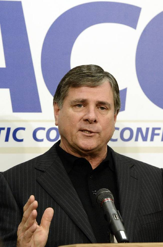 File-This Nov. 28, 2012, file photo shows Louisville athletic director Tom Jurich addressing reporters during a news conference in Louisville, Ky. The musical chairs of conference realignment returns this this week, with more major colleges taking new seats. On Tuesday, July 1, 2014, 12 FBS teams officially switch places, including Louisville in the Atlantic Coast Conference and Maryland and Rutgers in the Big Ten