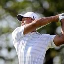 Tiger Woods tees off on the 15th hole during The Greenbrier Classic PGA Golf tournament in White Sulphur Springs, W.Va., Thursday, July 5, 2012. Woods finished the day at 1 -over 71. (AP Photo/The Roanoke Times, Kyle Green)