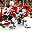 Detroit Red Wings left wing Johan Franzen (93) checks New Jersey Devils center Travis Zajac (19) to the ice to prevent a shot in the third period of an NHL hockey game in Detroit, Friday, Nov. 7, 2014. Detroit won 4-2 The Associated Press