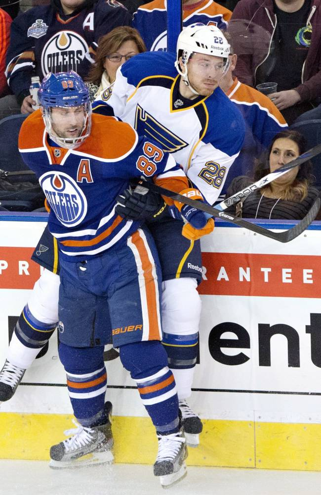 St. Louis Blues' Ian Cole (28) is checked by Edmonton Oilers' Sam Gagner (89) during the first period of an NHL hockey game in Edmonton, Alberta, on Saturday, Dec. 21, 2013