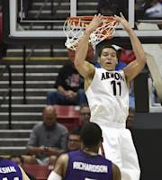 Arizona forward Aaron Gordon puts in a reverse dunk as Weber State defenders watch during the first half in a second-round game in the NCAA college basketball tournament Friday, March 21, 2014, in San Diego. (AP Photo/Denis Poroy)