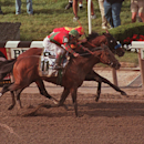 ADVANCE FOR WEEKEND EDITIONS, MAY 23-24 - FILE - In this June 6, 1998, file photo, Victory Gallop (11), with Gary Stevens up, edges out Real Quiet, with Kent Desormeaux up, as they cross the finish line in the 130th running of the Belmont Stakes at Belmont Park in Elmont, N.Y. (AP Photo/Bill Kostroun, File)