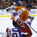 Washington Capitals' Troy Brouwer collides with Philadelphia Flyers' Adam Hall during the third period of an NHL hockey game, Wednesday, March 5, 2014, in Philadelphia. Philadelphia won 6-4 The Associated Press