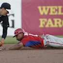 Philadelphia Phillies Ben Revere steals second ahead of the tag by New York Yankees third baseman Kelly Johnson in the first inning of an exhibition baseball game in Tampa, Fla., Tuesday, March 25, 2014 The Associated Press