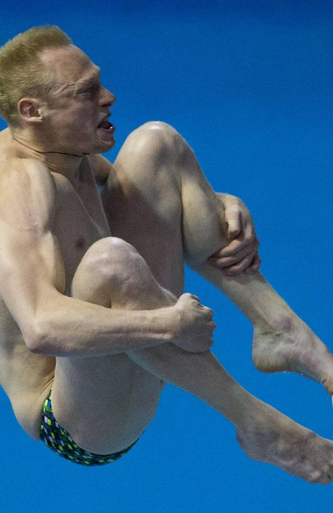 Russia's Ilia Zakharov competes during the men's 3m springboard diving final at the LEN Swimming European Championships in Berlin, Germany, Thursday, Aug. 21, 2014