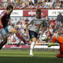 West Ham United's Stewart Downing, left, missed a chance to score pass Tottenham Hotspur's goalkeeper Hugo Lloris during their English Premier League soccer match at Upton Park, London, Saturday, Aug. 16, 2014