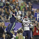 Seattle Seahawks wide receiver Chris Matthews (13), left, receives a pass against New England Patriots cornerback Kyle Arrington (25) during the second half of NFL Super Bowl XLIX football game Sunday, Feb. 1, 2015, in Glendale, Ariz The Associated Press