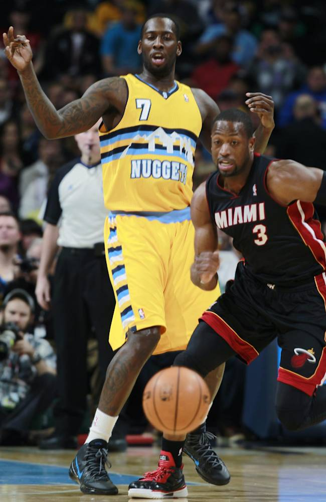 James returns to lead Heat past Nuggets 97-94
