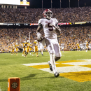 Alabama wide receiver Amari Cooper (9) makes a touchdown during the first quarter of an NCAA college football game against Tennessee, Saturday, Oct. 25, 2014, in Knoxville, Tenn. (AP Photo/AL.com, Vasha Hunt)