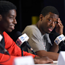 San Diego State forward Dwayne Polee II, left, answers questions as guard Xavier Thames listens during a news conference at the NCAA men's college basketball tournament, Wednesday, March 26, 2014, in Anaheim, Calif. San Diego State is scheduled to play Ar