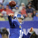 In the rain, New York Giants quarterback Eli Manning (10) throws a pass during the first half of an NFL football game against the Washington Redskins, Sunday, Dec. 29, 2013, in East Rutherford, N.J The Associated Press