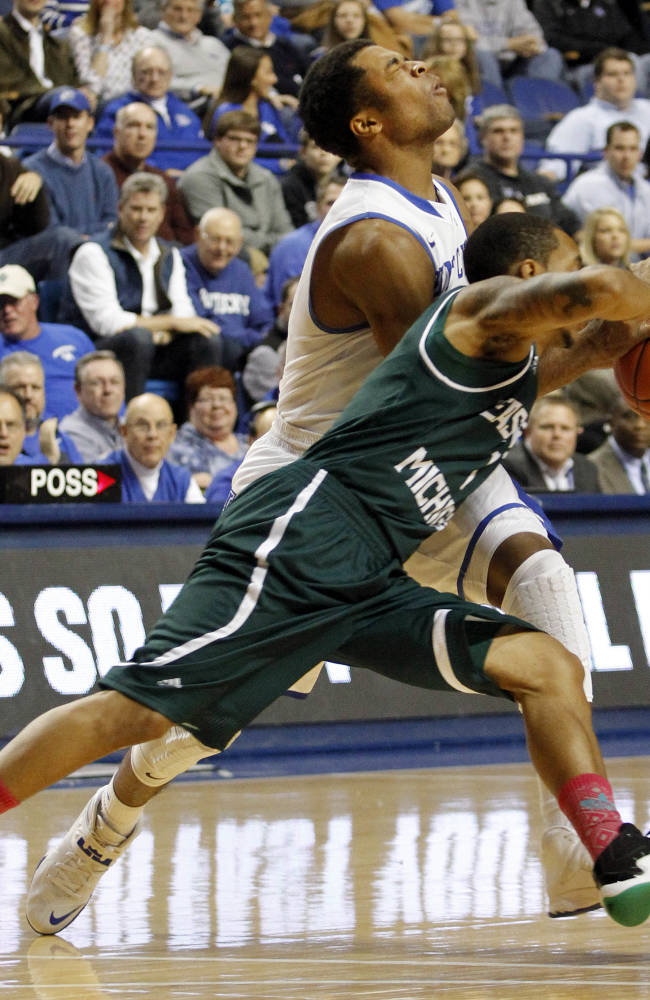 Kentucky's Andrew Harrison, top, and Eastern Michigan's Mike Talley collide during the first half of an NCAA college basketball game on Wednesday, Nov. 27, 2013, in Lexington, Ky