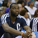 With his knee heavily wrapped, Al Jefferson #25 of the Charlotte Bobcats watches from the bench during the final minutes of a loss to the Miami Heat in Game Three of the Eastern Conference Quarterfinals during the 2014 NBA Playoffs at Time Warner Cable Arena on April 26, 2014 in Charlotte, North Carolina. The Heat won 98-85. (Photo by Grant Halverson/Getty Images)