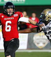 Northern Illinois quarterback Jordan Lynch (6) is chased down by Akron linebacker Jatavis Brown (53) during the first half of an NCAA college football game on Saturday, Oct. 12 , 2013, at Brigham Field at Huskie Stadium in DeKalb, Ill. (AP Photo/Jeff Haynes)
