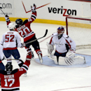 New Jersey Devils' Ryan Carter (20) and Michael Ryder (17) celebrate a goal by Carter as Washington Capitals' Jay Beagle (83), Mike Green (52) and Jaroslav Halak (41), of Slovakia, react during the third period of an NHL hockey game, Friday, April 4, 2014