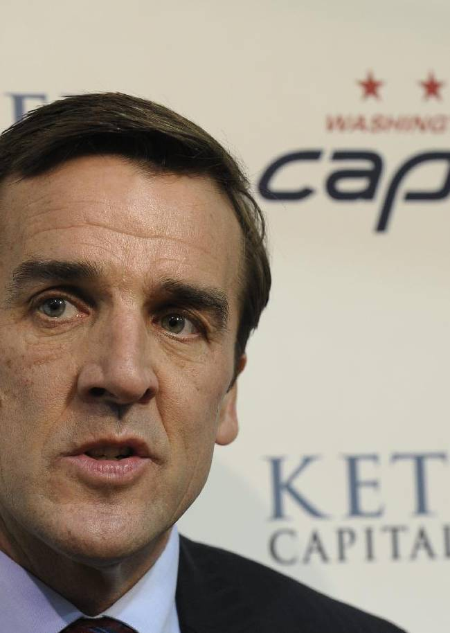 In this May 15, 2013, file photo, Washington Capitals general manager George McPhee talks with reporters at the Kettler Iceplex in Arlington, Va. Four years ago, Jaroslav Halak shut down Alex Ovechkin's top-seeded Washington Capitals in the first round of the Stanley Cup playoffs. Now the Capitals hope the goalie will help them reach the postseason.