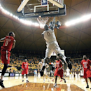 Wyoming's Leonard Washington (0) dunks the ball against San Diego State in the second half during an NCAA college basketball game on Saturday, Jan. 19, 2013, in Laramie, Wyo. (AP Photo/Laramie Daily Boomerang, Jeremy Martin)