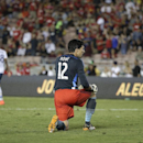 Los Angeles goalkeeper Brian Rowe kneels on the field after Manchester United's Ashley Young scored during the second half of a friendly soccer match at the Rose Bowl on Wednesday, July 23, 2014, in Pasadena, Calif. The Manchester United won 7-0. (AP Phot