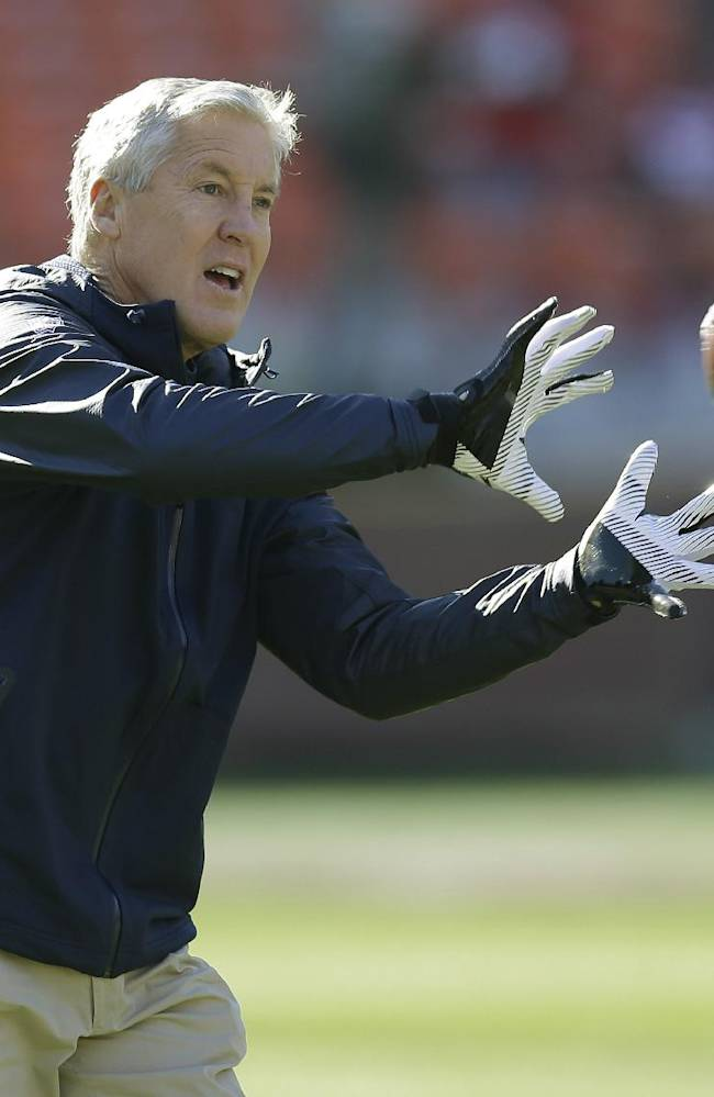 Seattle Seahawks head coach Pete Carroll catches a football during warmups before an NFL football game against the San Francisco 49ers Sunday, Dec. 8, 2013, in San Francisco