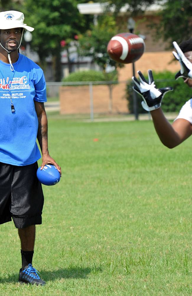 Buffalo Bills cornerback Mario Butler watches a passing drill before giving pointers during the inaugural Mario Butler Football FUNdamentals Camp, Saturday, June 21, 2014, in Jacksonville, Fla. Butler and his foundation teamed up with USA Football, a program of NFL Play 60, and other sponsors for the camp