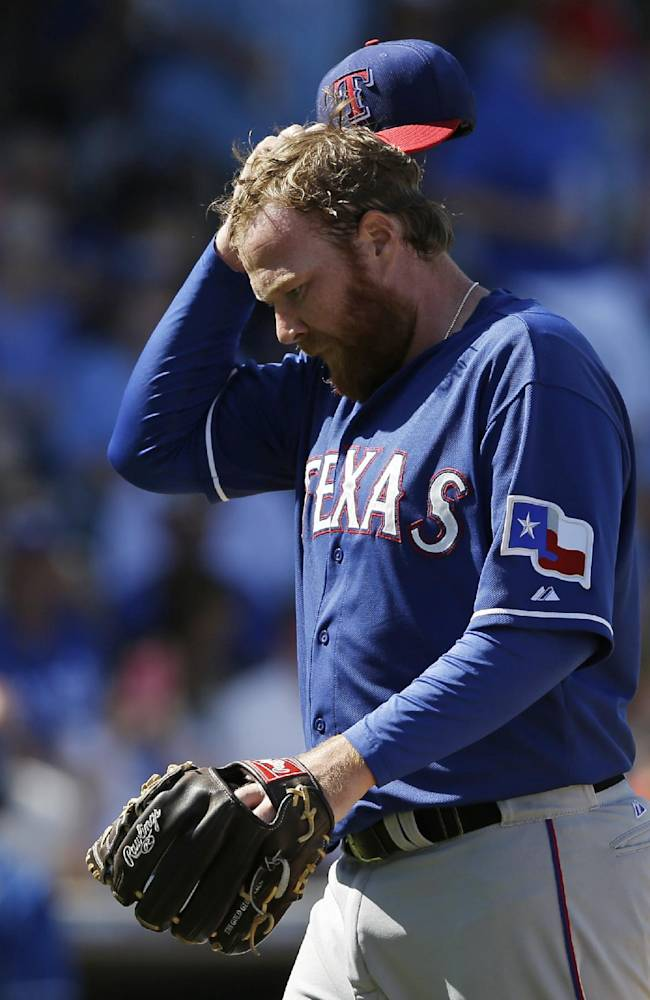 Texas Rangers' Tommy Hanson walks to the dugout after the fifth inning of a spring exhibition baseball game against the Kansas City Royals, Saturday, March 22, 2014, in Surprise, Ariz