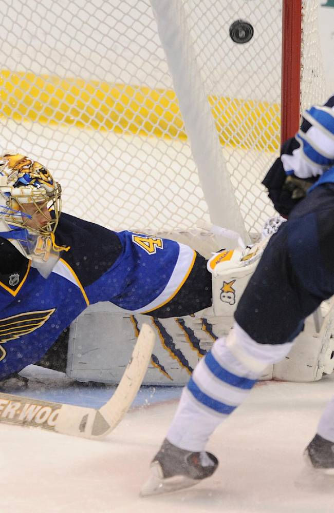 St. Louis Blues goalie Jaroslav Halak (41), of Slovakia, can't block a goal by Winnipeg Jets' Bryan Little (18) during the third period of an NHL hockey game Tuesday, Oct. 29, 2013, in St. Louis. The Blues won 3-2