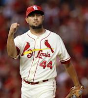 St. Louis Cardinals closer Edward Mujica reacts after a baseball game against the Atlanta Braves, Saturday, Aug. 24, 2013, at Busch Stadium in St. Louis. (AP Photo/St. Louis Post-Dispatch, Chris Lee)