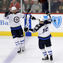 Winnipeg Jets defenseman Zach Bogosian (44) celebrates his goal with Andrew Ladd (16) during the first period of an NHL hockey game against the Chicago Blackhawks Friday, Jan. 16, 2015, in Chicago The Associated Press