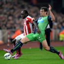 Stoke City's Victor Moses, left, battles for the ball with Newcastle United's Daryl Janmaat, during the English Premier League soccer match between Stoke City and Newcastle United, at the Britannia Stadium, in Stoke on Trent, England, Monday Sept. 29, 201