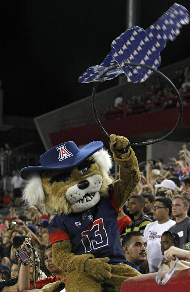 Arizona mascot Wilbur rattles his keys on opening kickoff against Utah in the first half of an NCAA collge football game, Saturday, Oct. 19, 2013 in Tucson, Ariz. Arizona won 35 to 24