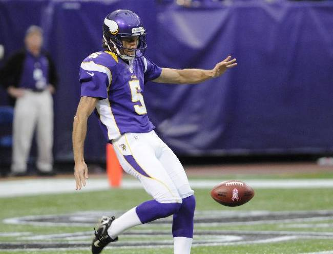 Minnesota Vikings punter Chris Kluwe (5) punts in the first half of an NFL football game in Minneapolis, Sunday, Oct. 21, 2012
