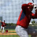 St. Louis Cardinals pitcher Adam Wainwright, left, throws live batting practice to Jhonny Peralta during spring training baseball practice Friday, Feb. 21, 2014, in Jupiter, Fla The Associated Press