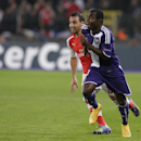Anderlecht's Frank Acheampong, right, goes forward as Arsenal's Santi Cazorla tracks during the Group D Champions League match between Anderlecht and Arsenal at Constant Vanden Stock Stadium in Brussels, Belgium, Wednesday Oct. 22, 2014
