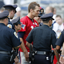 New England Patriots quarterback Tom Brady, center, poses for a group photo with area police following NFL football training camp in Foxborough, Mass., Saturday, July 26, 2014. (AP Photo) The Associated Press
