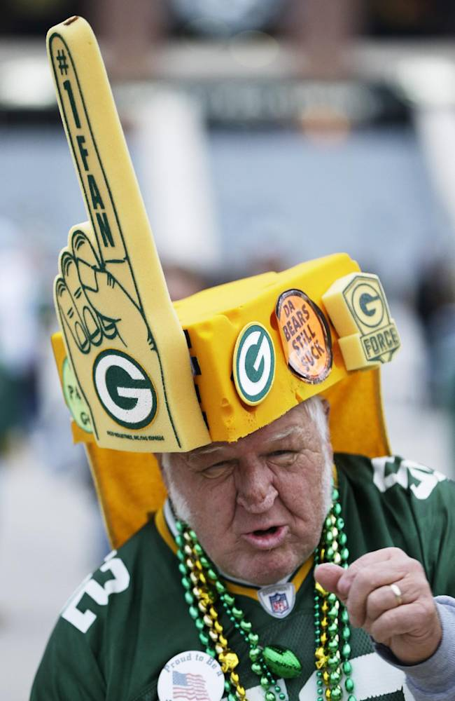 Green Bay Packers fan Gene Greening cheers before NFL football game against the Chicago Bears Monday, Nov. 4, 2013, in Green Bay, Wis