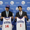 Philadelphia 76ers newly drafted players Arsalan Kazemi, left, of Iran, and Michael Carter-Williams pose with their jerseys after a news conference at the team's NBA basketball practice facility, Friday, June 28, 2013, in Philadelphia. (AP Photo/Matt Slocum)