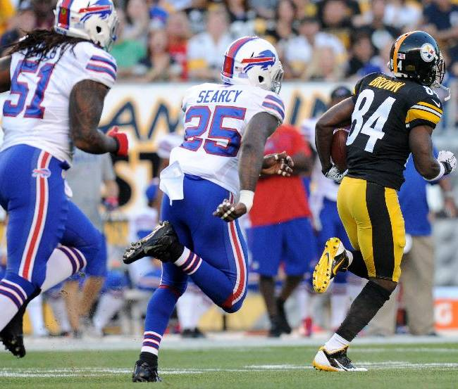 Pittsburgh Steelers wide receiver Antonio Brown (84) runs past Buffalo Bills strong safety Da'Norris Searcy (25) and middle linebacker Brandon Spikes (51) on his way to a touchdown in the first quarter of an NFL football preseason game on Saturday, Aug. 16, 2014, in Pittsburgh