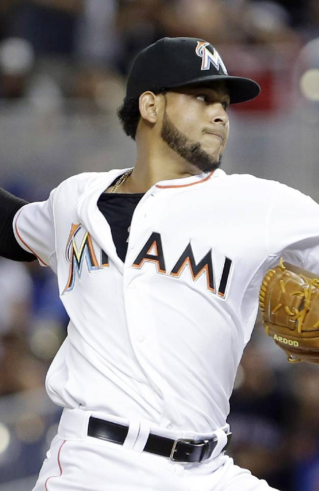 Miami Marlins' Henderson Alvarez delivers a pitch during the ninth inning of a baseball game against the New York Mets, Tuesday, May 6, 2014, in Miami. Alvarez pitched a six-hitter for his second shutout this season. Alvarez now has four career shutouts, including a no-hitter against Detroit on the final day of last season