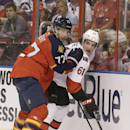Florida Panthers defenseman Tom Gilbert (77) holds Ottawa Senators right wing Mark Stone (61) to the boards as they battle for the puck during the first period of an NHL hockey game, Tuesday, March 25, 2014 in Sunrise, Fla The Associated Press