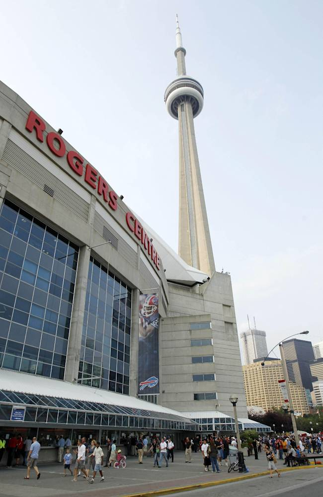 FILE- In this Aug. 19, 2012 file photo, fans walk in front of the Rogers Centre in Toronto, before a preseason NFL football game between the Indianapolis Colts and Buffalo. On Sunday, Dec. 1, 2013, The Atlanta Falcons play the Buffalo Bills in a