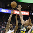 Phoenix Suns' Markieff Morris (11) shoots as Utah Jazz's Richard Jefferson (24) defends in the first half during an NBA basketball game Friday, Nov. 29, 2013, in Salt Lake City. The Suns won 112-101 The Associated Press